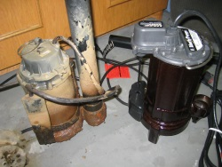 Toronto-plumbers-Replacing old sump pump with new one