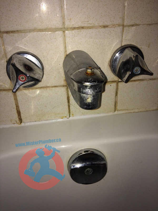 Old handles bathtub faucet