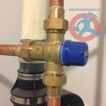mixing-valve-installed-above-hot-water-tank