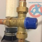 mixing-valve-installed-above-hot-water-tank-s