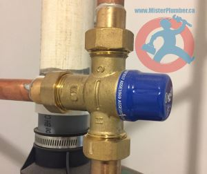 Mixing valve installed above hot water tank s