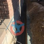 Trench for exterior foundation wall waterproofing s