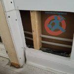 cutting-drywall-to-repair-pipe