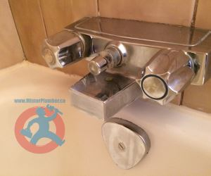 Old two handle bathtub faucet s