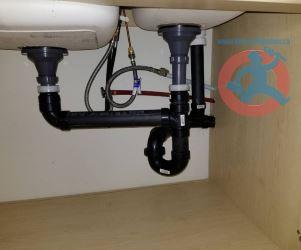 drain pipes under kitchen sink s