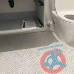 Toilet and vanity in basement s