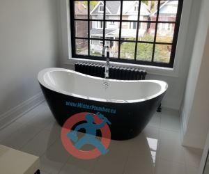 Bathtub in master washroom s