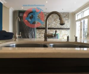Kitchen tap in Toronto house-s