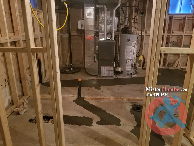 Drain relocation for basement renovation project in Toronto