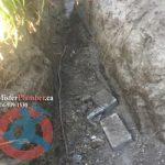 Exposed underground main water supply pipe