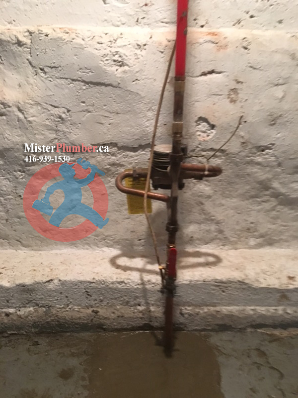 Water meter near front wall in the basement