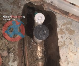 Backwater valve with downstream clean-out in Toronto basement