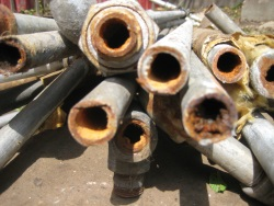 Corrosion in galvanized pipes reduces water pressure