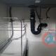 Plumbing under single compartment kitchen sink