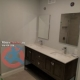 Renovated washroom with new double vanity in Toronto
