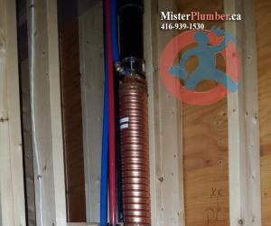 Drain heat recovery system in the basement