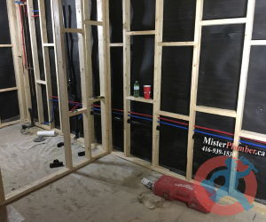 Installation of PEX water pipes in the basement
