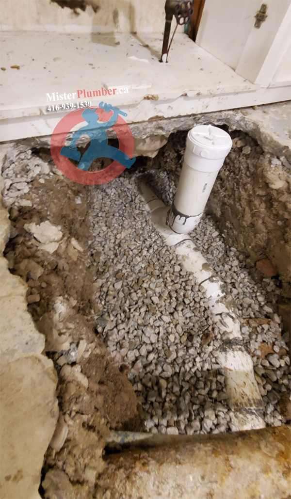 Main drain clean-out near front wall in the basement