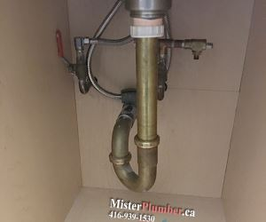 Brass drain connection under the sink in Toronto condo unit
