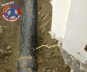 Main drain pipe under concrete floor in the Toronto basement