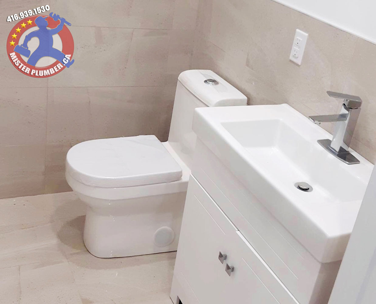 New modern toilet and vanity installed by Mister Plumber