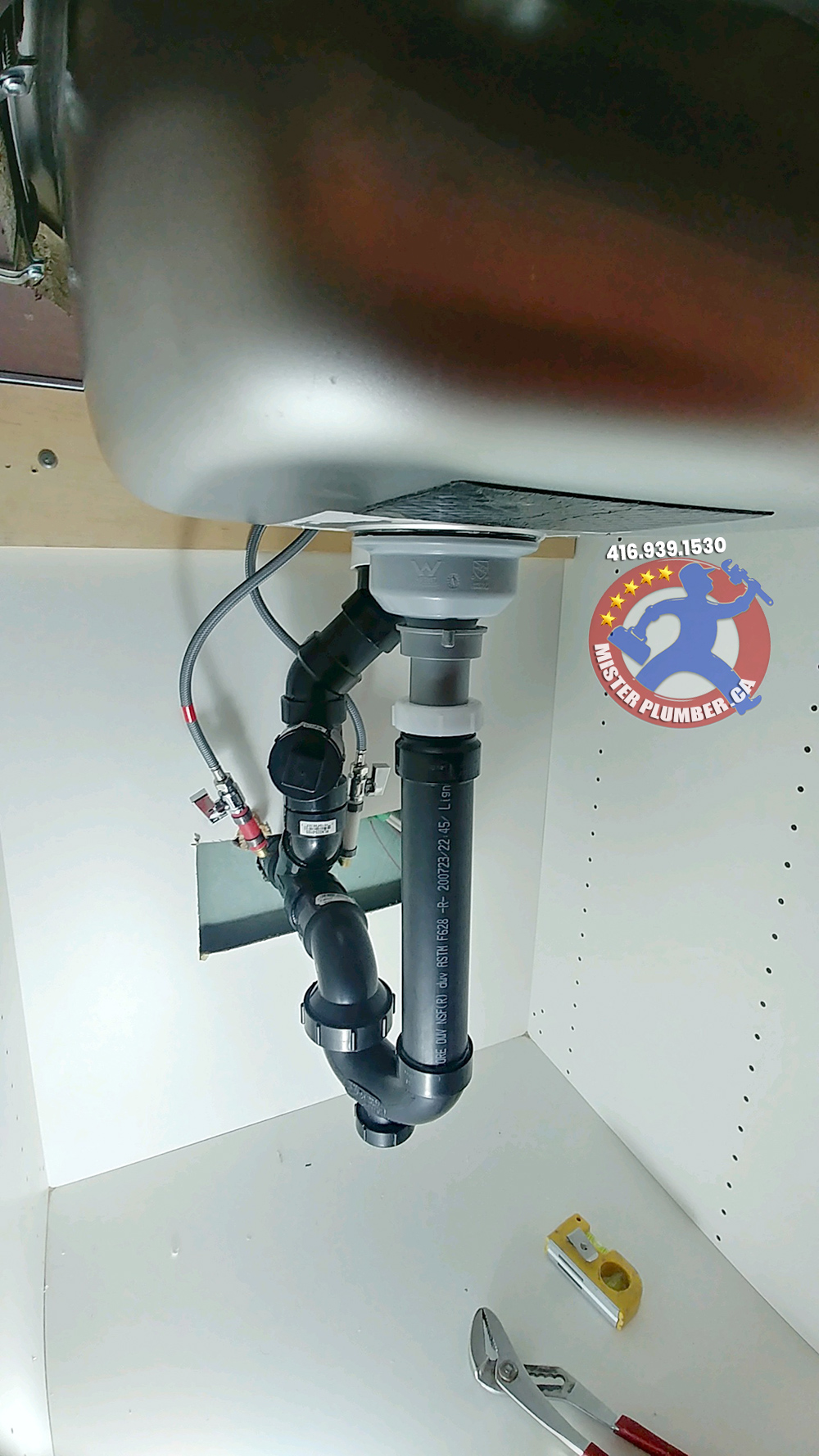Under kitchen sink plumbing connection done by plumber in Etobicoke