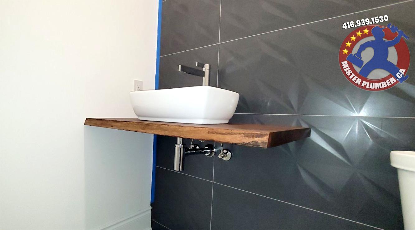 Modern powder room sink by Mister Plumber