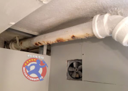 corroded leaky drain pipe