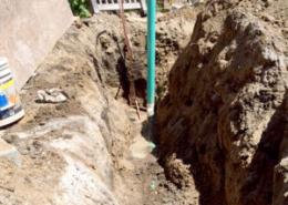 Underground drain and water line installation